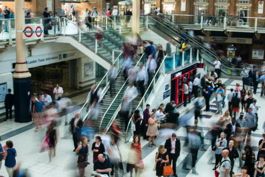 Commuters pictured at a major railway station in London